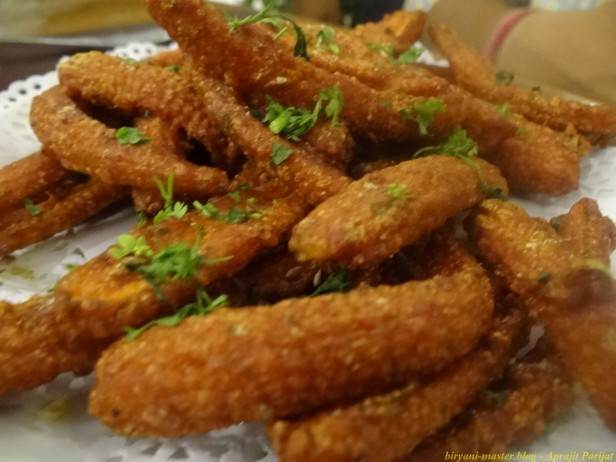 Baby Corn Amritsari - 3/5, a crispy and mildly spiced preparation.